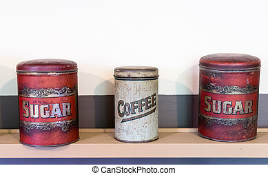 Three tin cans coffee and sugar - Three tins on shelf in...