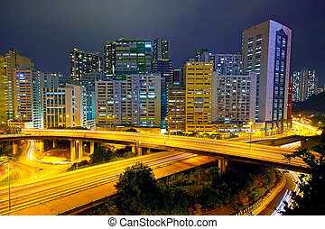 Colorful city night with buildings and bridge