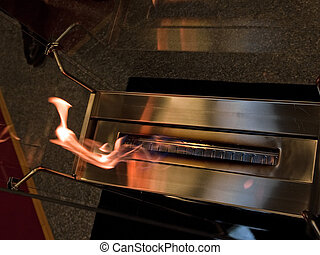 Modern design fireplace made of brushed metal and open...