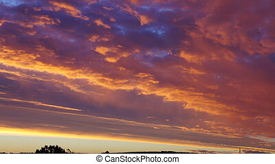 Morning sky - Clouds are illuminated by the rising sun,