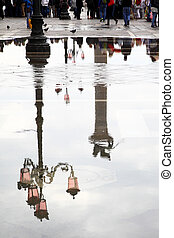 Venice reflects in puddle, Saint Mark's square, Italy