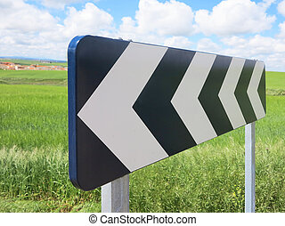 Traffic signal, black and white arrow
