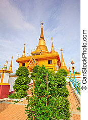 Golden pagoda at Wat Khiri Wong Temple in Nakhon Sawan...