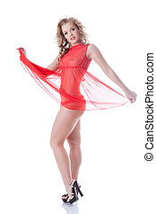 Exquisite slim girl posing in red negligee, isolated on...