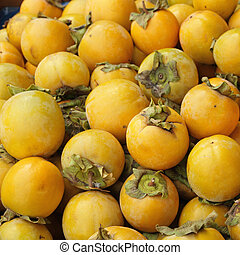 many persimona fruits as background, image from tuscan...