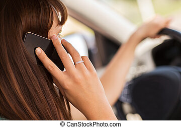 woman using phone while driving the car - transportation and...