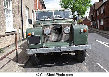 Retro offroad vehicle - Old green offroad vehicle on the...