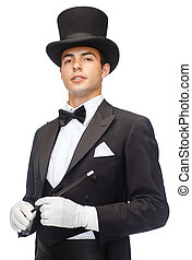 magician in top hat with magic wand showing trick -...