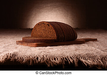 Sliced rye bread on rustic background