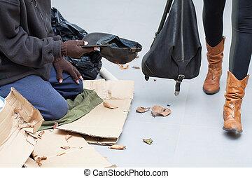 Homeless man begging for money on the street - Homeless...