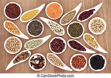 Healthy Food - Dried pulses selection in white porcelain...
