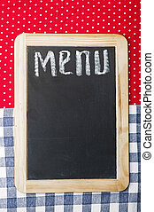 Menu title written with chalk on blackboard lying on...