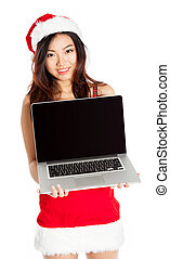 Sexy asian santa claus holding a laptop with blank screen -...