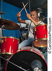 Cheerful musician playing drums - Drummer playing the drums...