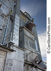 industrial background - old grain elevator against sky -...