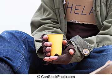 Hands of homeless with a paper cup - Hands of homeless...