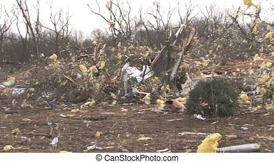 Home Wreckage 1 - Panning across the path of destruction of...