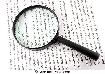 magnifying lens - The black lens on page of book
