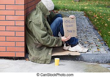 Homeless begging for money