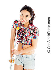 Isolated on white sexy asian cowgirl injured with a crutch