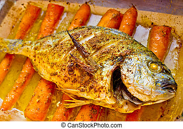 Dorade with curry on carrots in oriental style - Dorade...