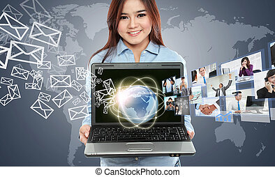 Portrait of businesswoman using laptop and showing...