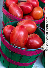 Farmers Market - Fresh locally grown red roma tomatoes in...
