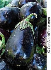 Farmers Market - Organically grown purple eggplant on...