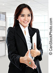 Picture of businesswoman with an open hand ready for handshake