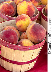 Farmers Market - Fresh locally grown yellow peaches in small...
