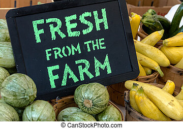 Farmers Market - Fresh from the Farm sign on table full of...