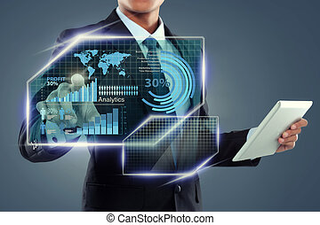 Businessman with tablet computer working on screen