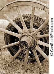 new and old wheel - new and old broken wagon car wheel
