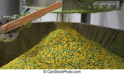Industrial Plastic Creation - Bright yellow plastic pellets...