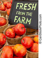 Farmers Market - Locally grown re tomatoes for sale at local...
