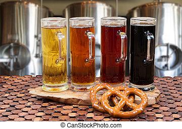 beer flight of four sampling mugs of light and dark craft...