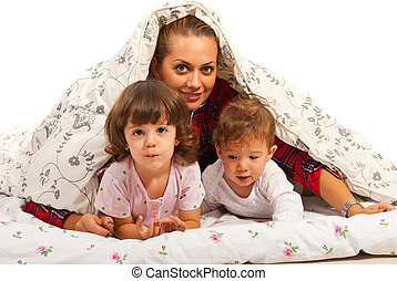 Happy mom with kids in bed - Happy mom with two kids in bed...