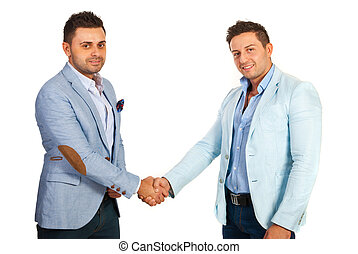 Business men shaking hands - Business men shaking their...