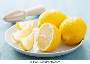 fresh lemon sliced over blue