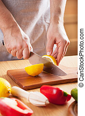 chef cutting lemon