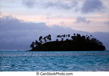 Muri Lagoon in Rarotonga Cook Islands - Silhouette of small...
