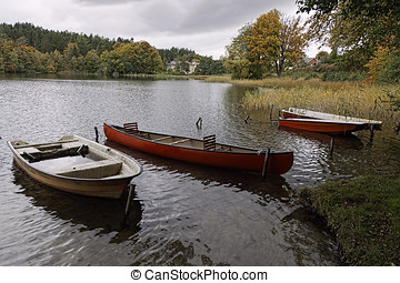 Dinghies in a Lake - Dinghies and a canoe in lake Almind...