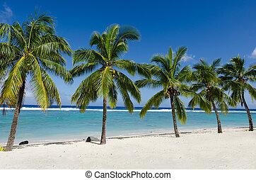 Titikaveka beach in Rarotonga Cook Islands - Line of five...
