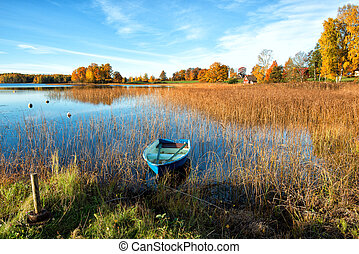 Autumn in Sweden - Glorious autumn morning by a lake in...
