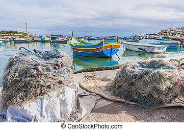 Kajjik Boat at Marsaxlokk harbor in Malta - Traditional...