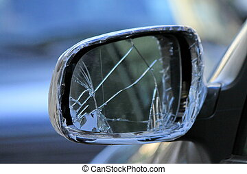 Damaged rearview mirror on a car - Close up of damaged...