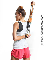 Stretching back muscles - athletic woman stretching back...