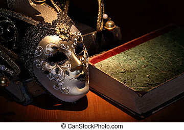 Mask And Book - Vintage still life. Nice Venetian mask near...