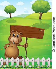A beaver holding an empty signboard standing near the fence...