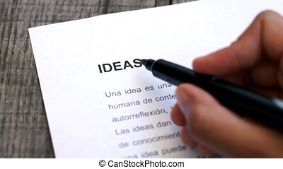 Circling Ideas with a pen - A person Circling Ideas with a...